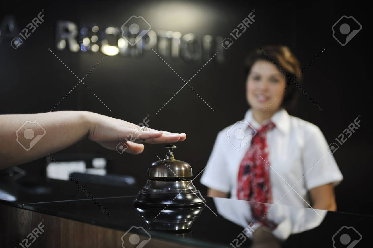 smiling businesswoman at the reception desk working Stock Photo - 7814693