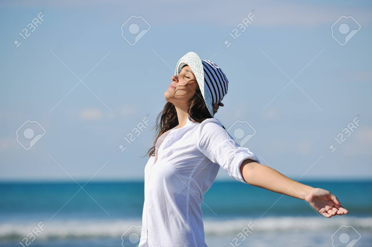 happy young woman relax onbeautiful  beach at morning Stock Photo - 8236124