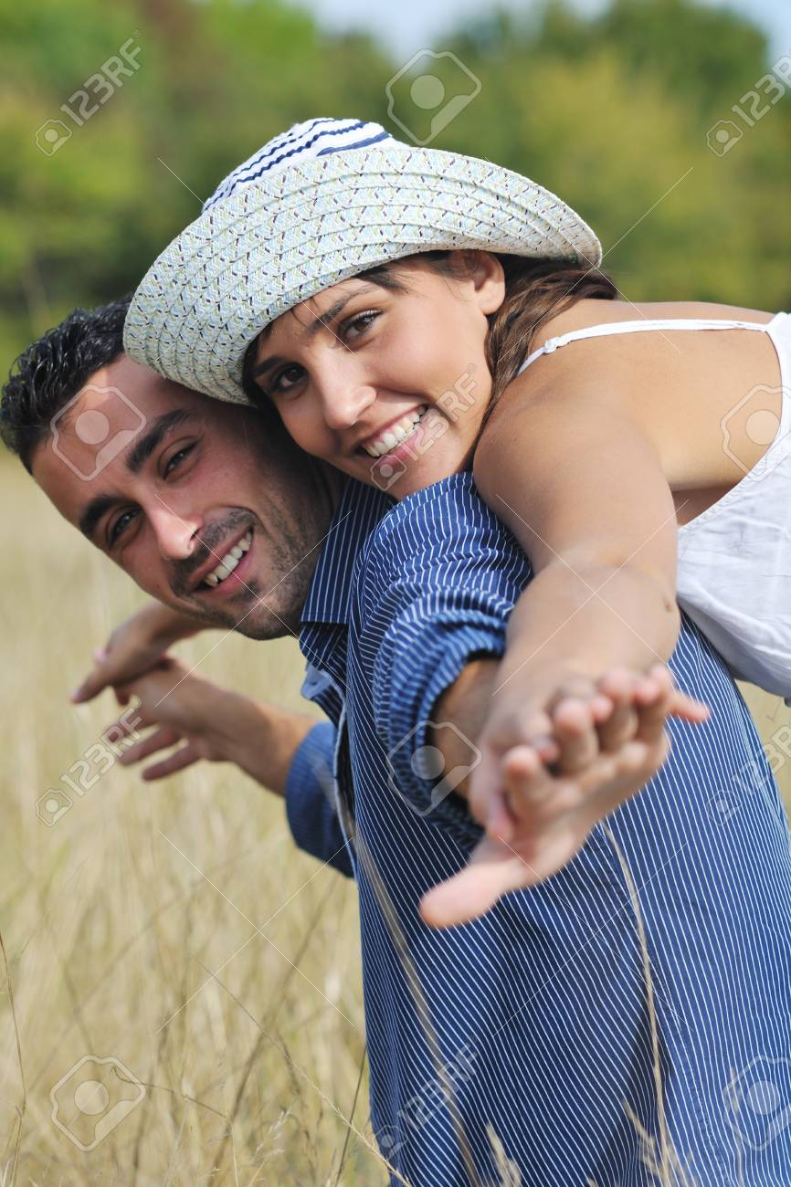 happy young couple have romantic time outdoor while smiling and hug Stock Photo - 8327789