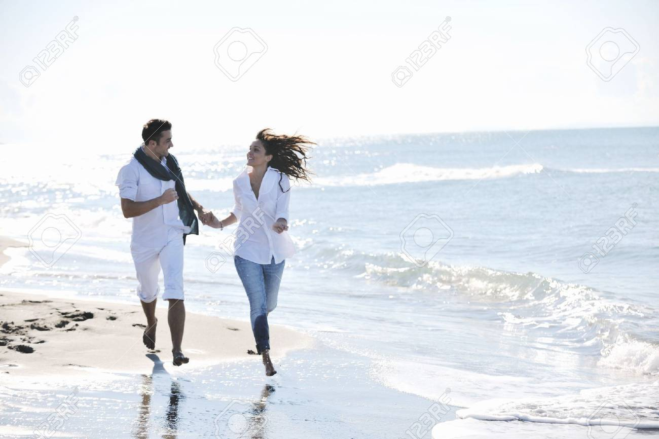 happy young couple in white clothing  have romantic recreation and   fun at beautiful beach on  vacations Stock Photo - 8313811