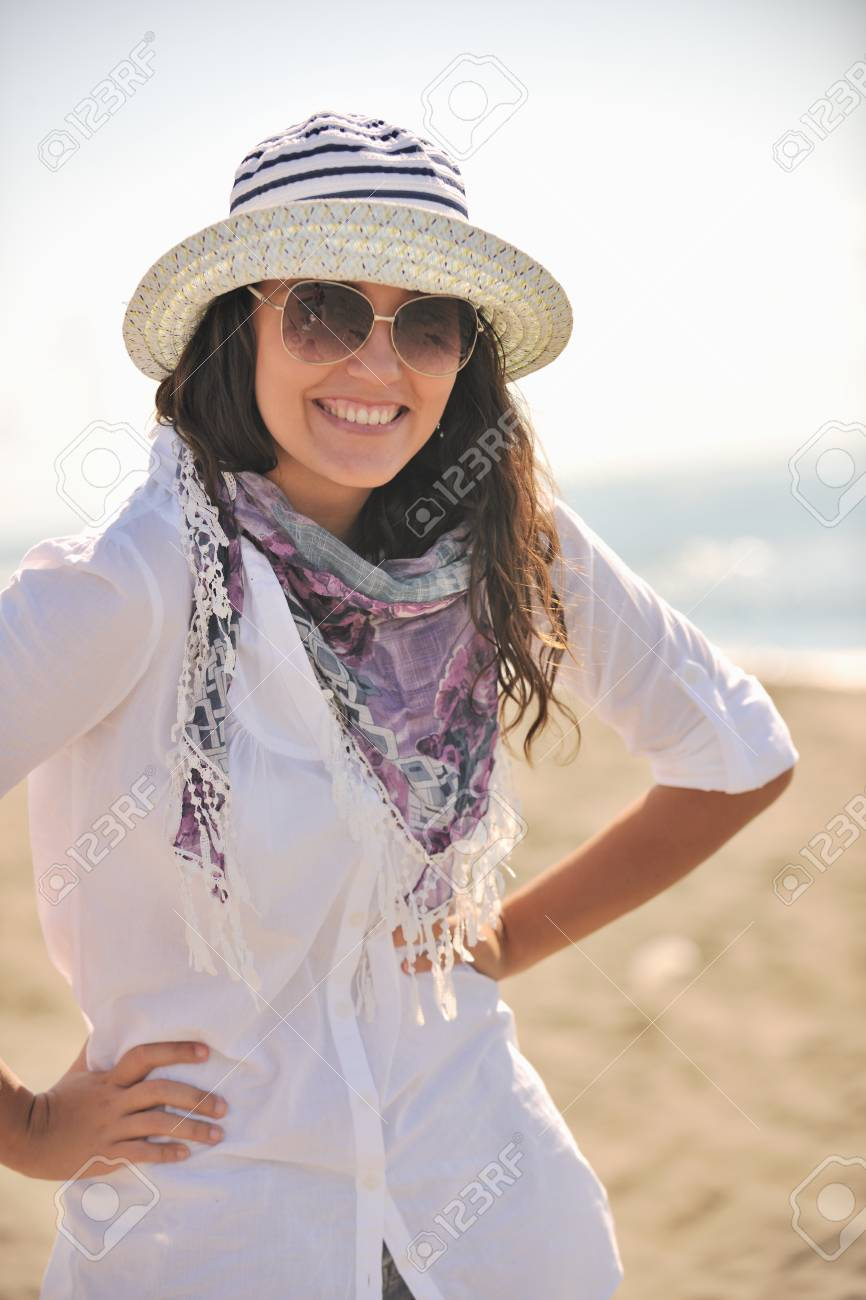 happy young woman relax onbeautiful  beach at morning Stock Photo - 8314127