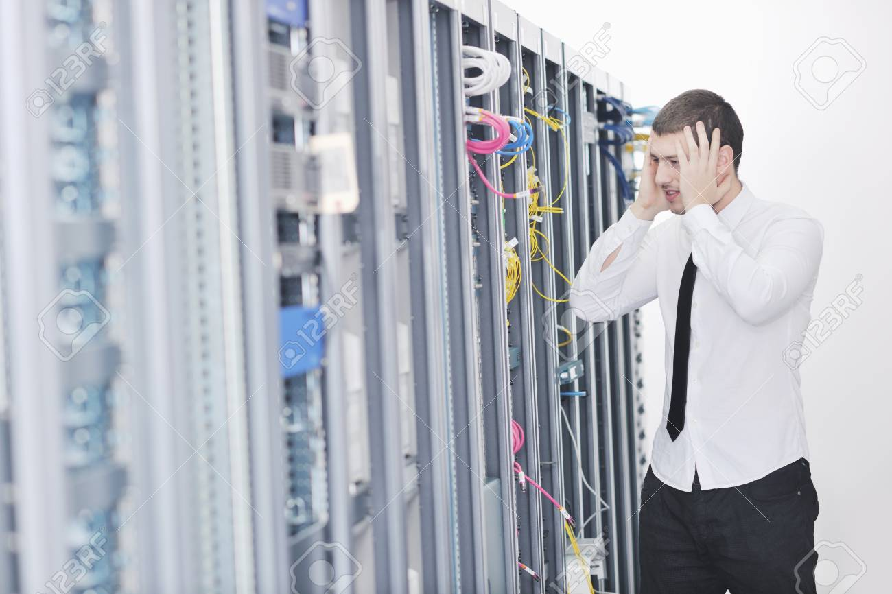 young handsome business man  engeneer in datacenter server room Stock Photo - 8437137