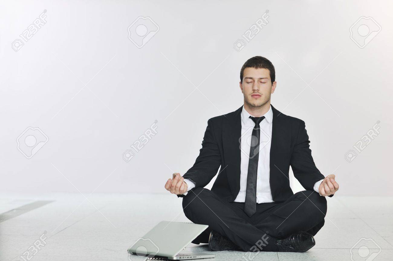 young handsome business man in black suit and tie practice yoga and relax at network server room while representing stres control concept Stock Photo - 8445697
