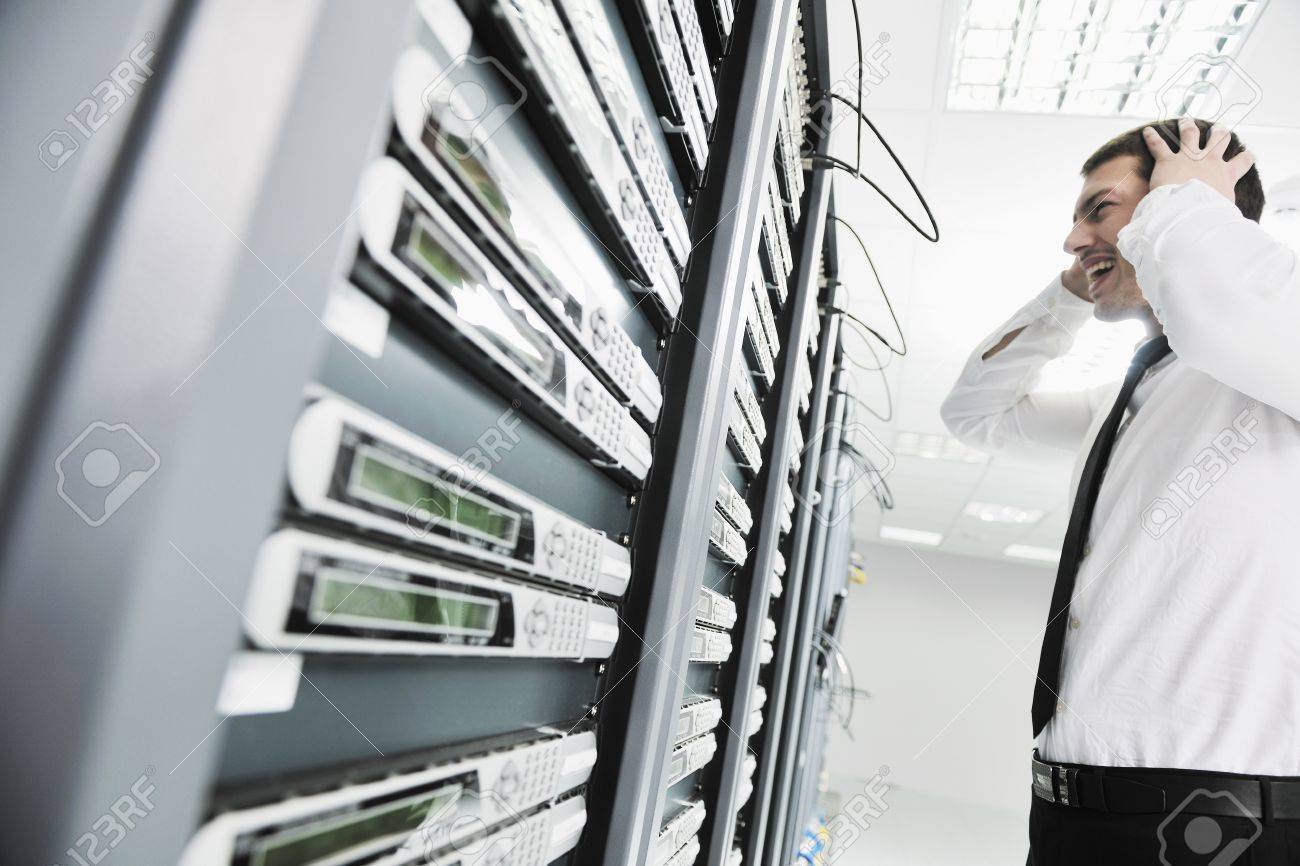 business man in network server room have problems and looking for  disaster solution Stock Photo - 8445696
