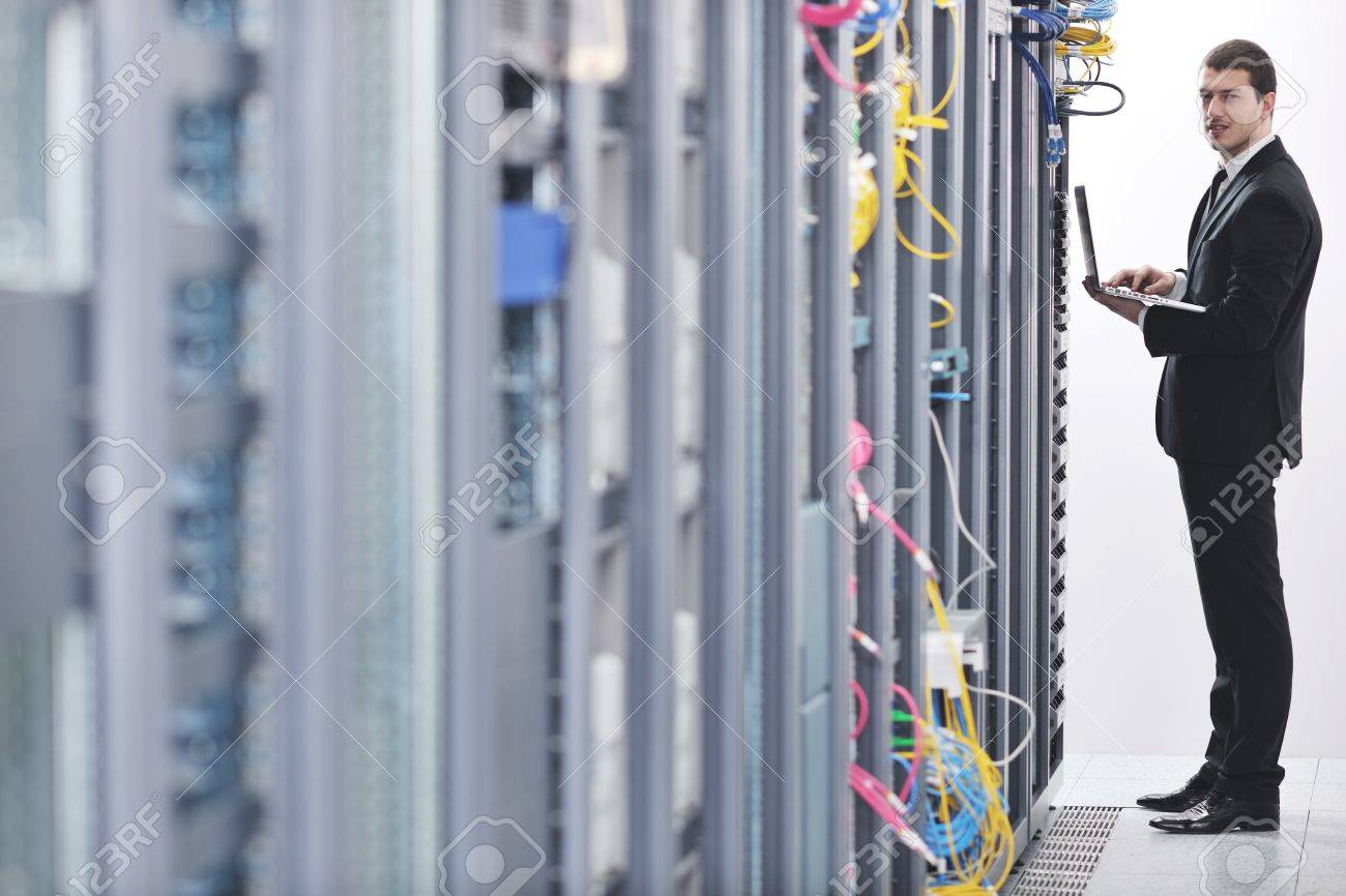young engeneer business man with thin modern aluminium laptop in network server room Stock Photo - 8445736