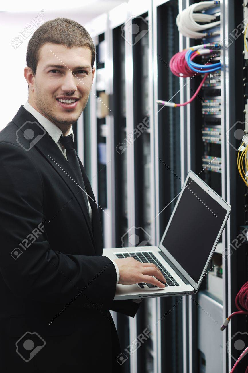 young engeneer business man with thin modern aluminium laptop in network server room Stock Photo - 8445724