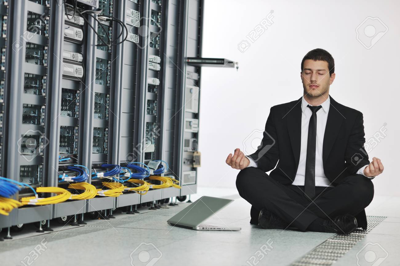 young handsome business man in black suit and tie practice yoga and relax at network server room while representing stres control concept Stock Photo - 8445732