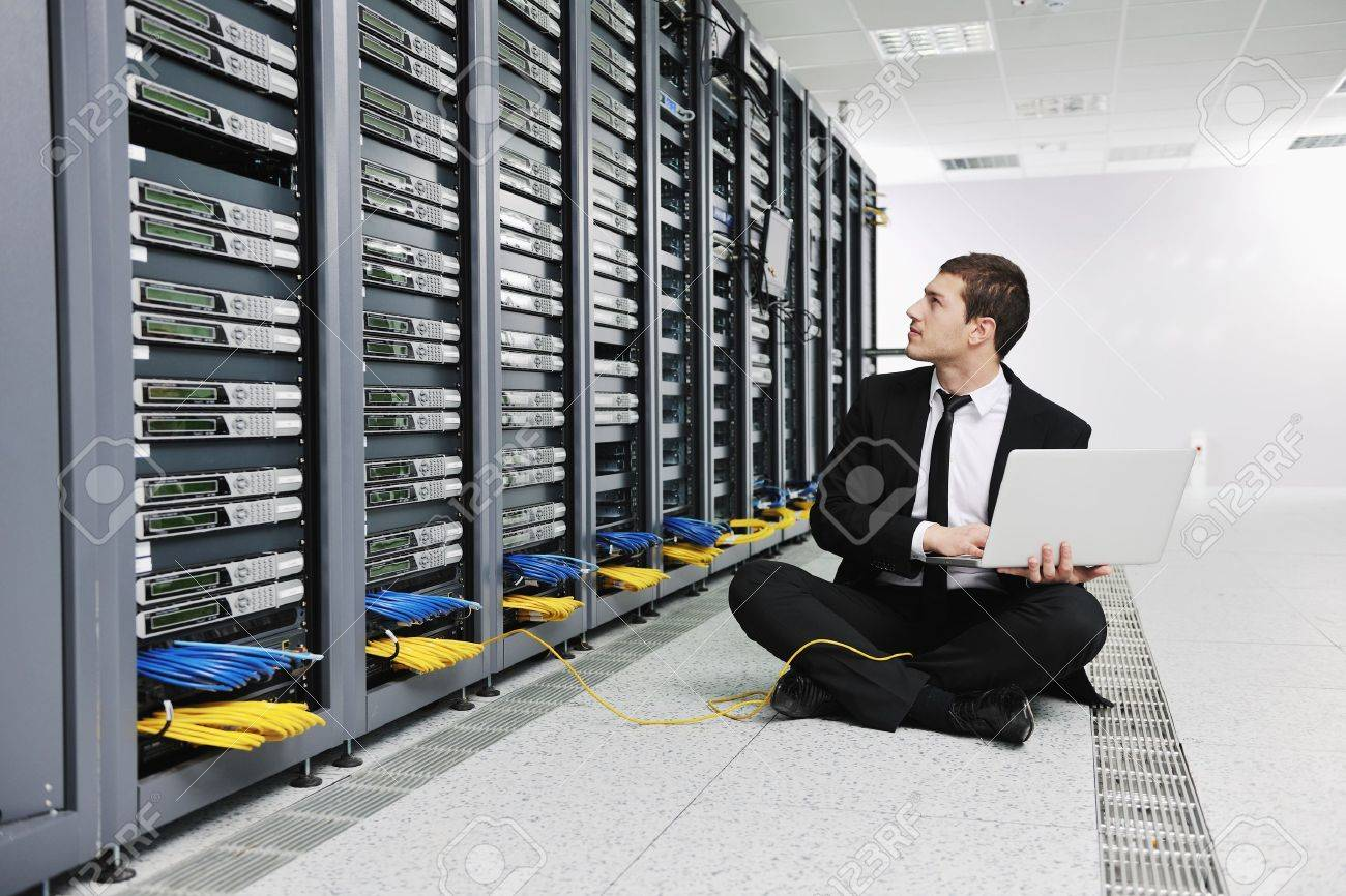 young engeneer business man with thin modern aluminium laptop in network server room Stock Photo - 8445756
