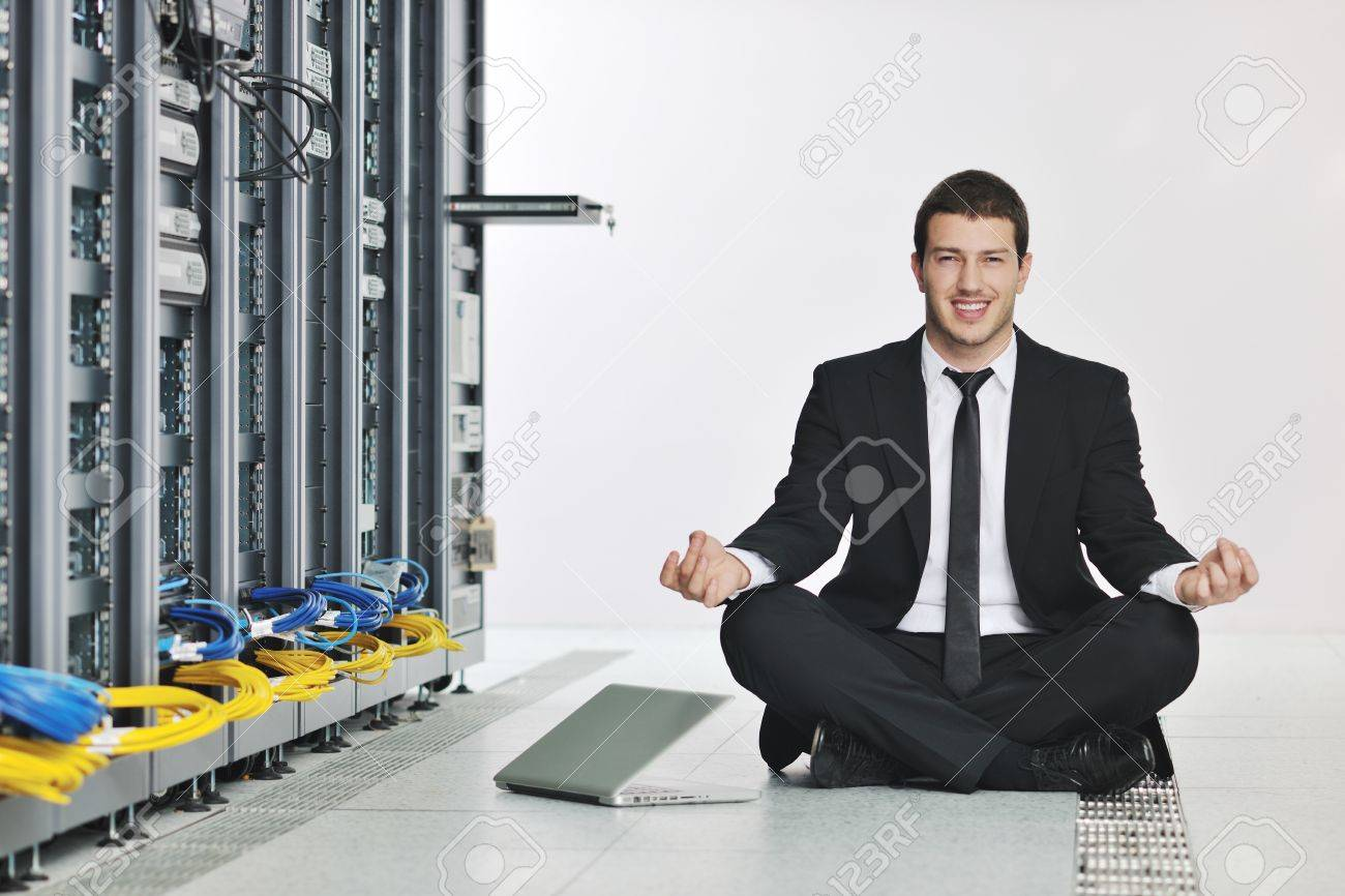 young handsome business man in black suit and tie practice yoga and relax at network server room while representing stres control concept Stock Photo - 8445723