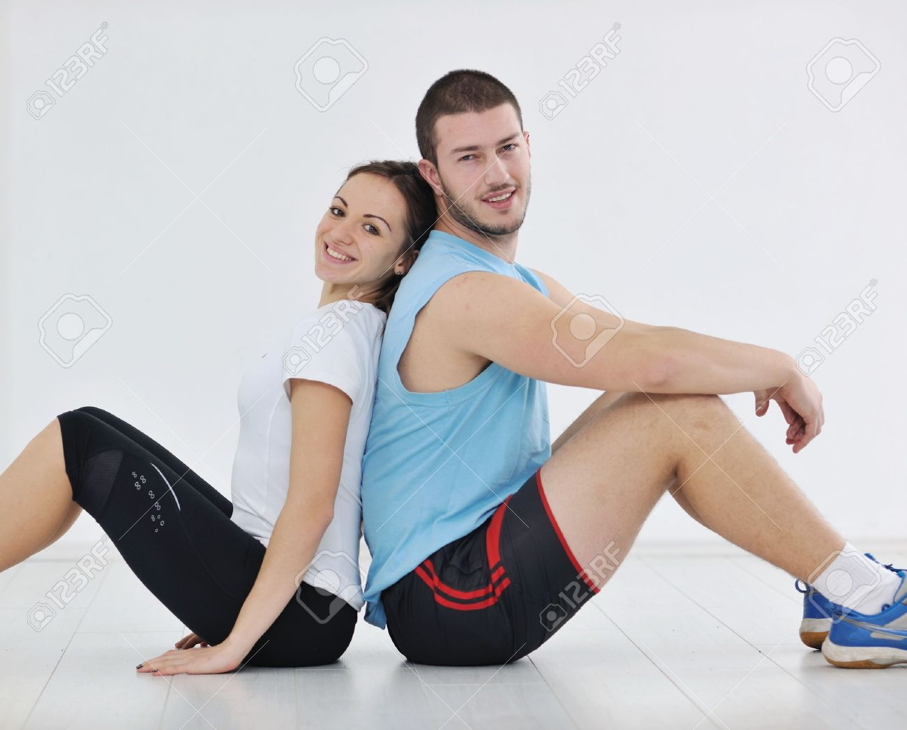 happy young couple fitness workout and fun at sport gym club Stock Photo - 9296434