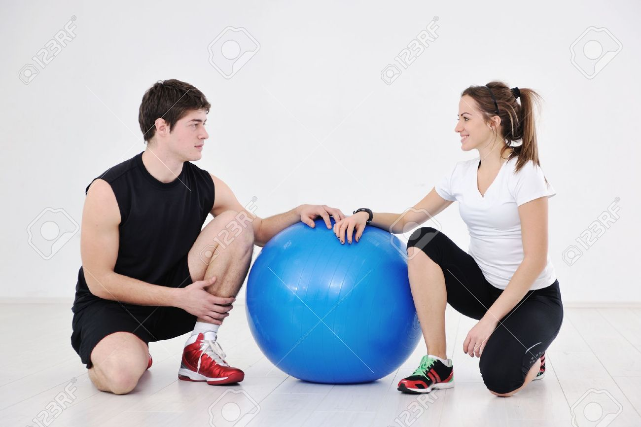 happy young couple fitness workout and fun at sport gym club Stock Photo - 8777144