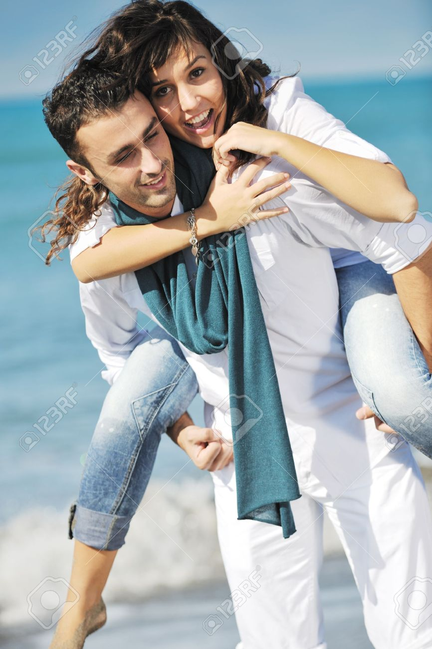happy young couple in white clothing  have romantic recreation and   fun at beautiful beach on  vacations Stock Photo - 8773439
