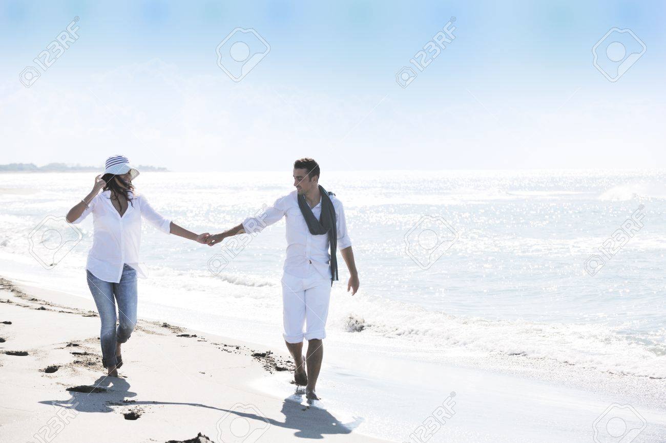 happy young couple in white clothing  have romantic recreation and   fun at beautiful beach on  vacations Stock Photo - 8773450