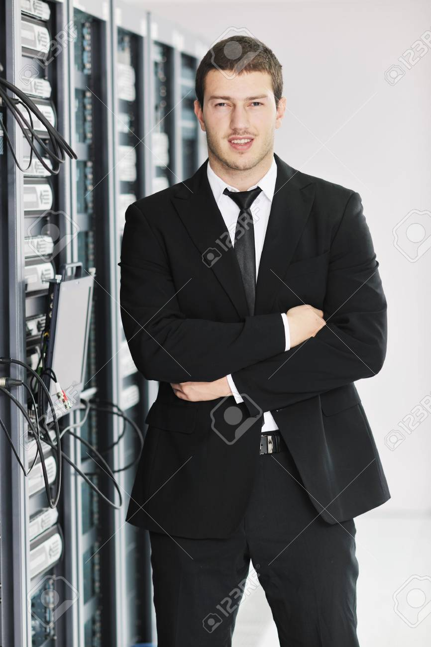 young handsome business man it  engeneer in datacenter server room Stock Photo - 8768781