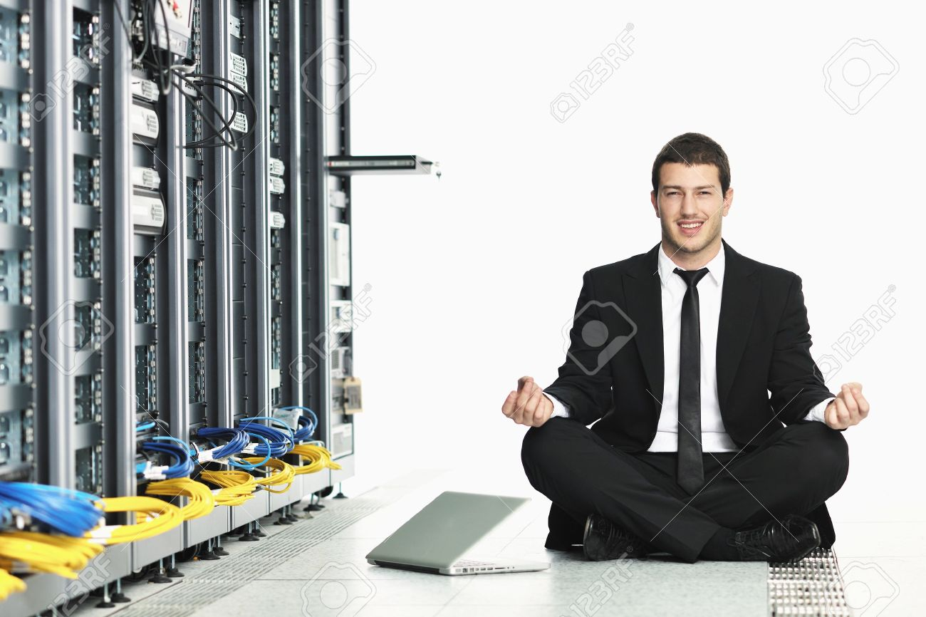 young handsome business man in black suit practice yoga and relax at network server room while representing stress control concept Stock Photo - 8768439