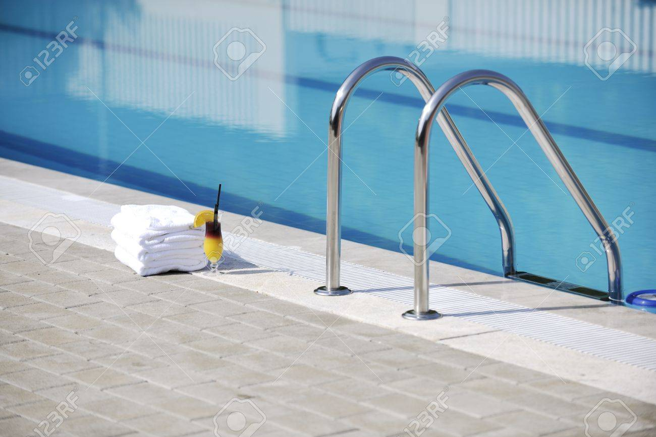 coctail dring with orange att sunny day on swimming pool side with white towel decoraton Stock Photo - 8881506