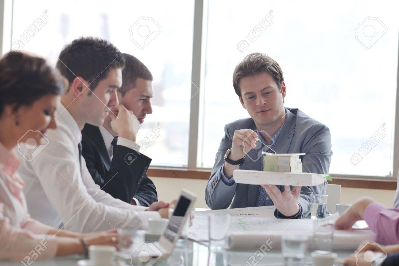 group of architect business team people on meeting looking model and desing of new real estate house Stock Photo - 9075070