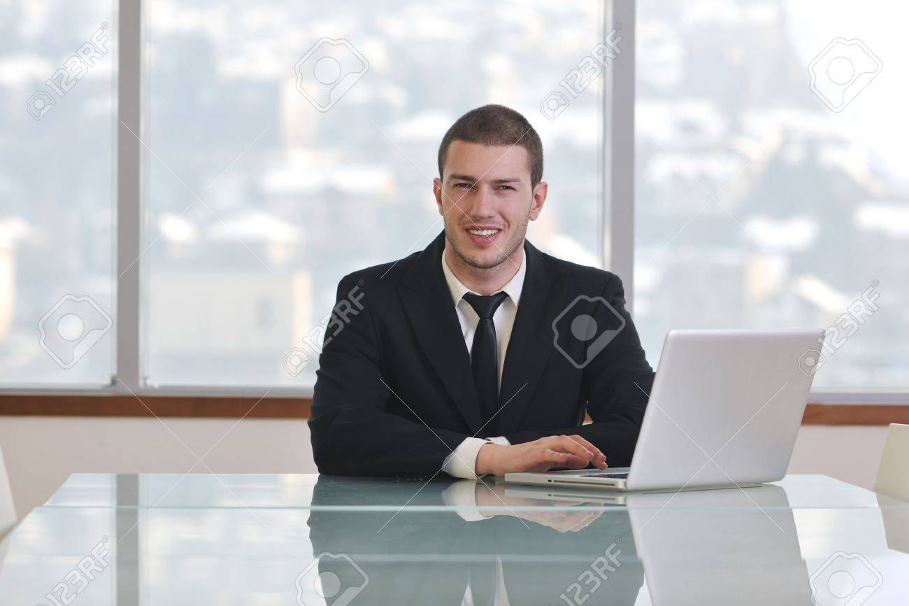 young business man lawyer with laptop alone in big bright   conference room Stock Photo - 9077380