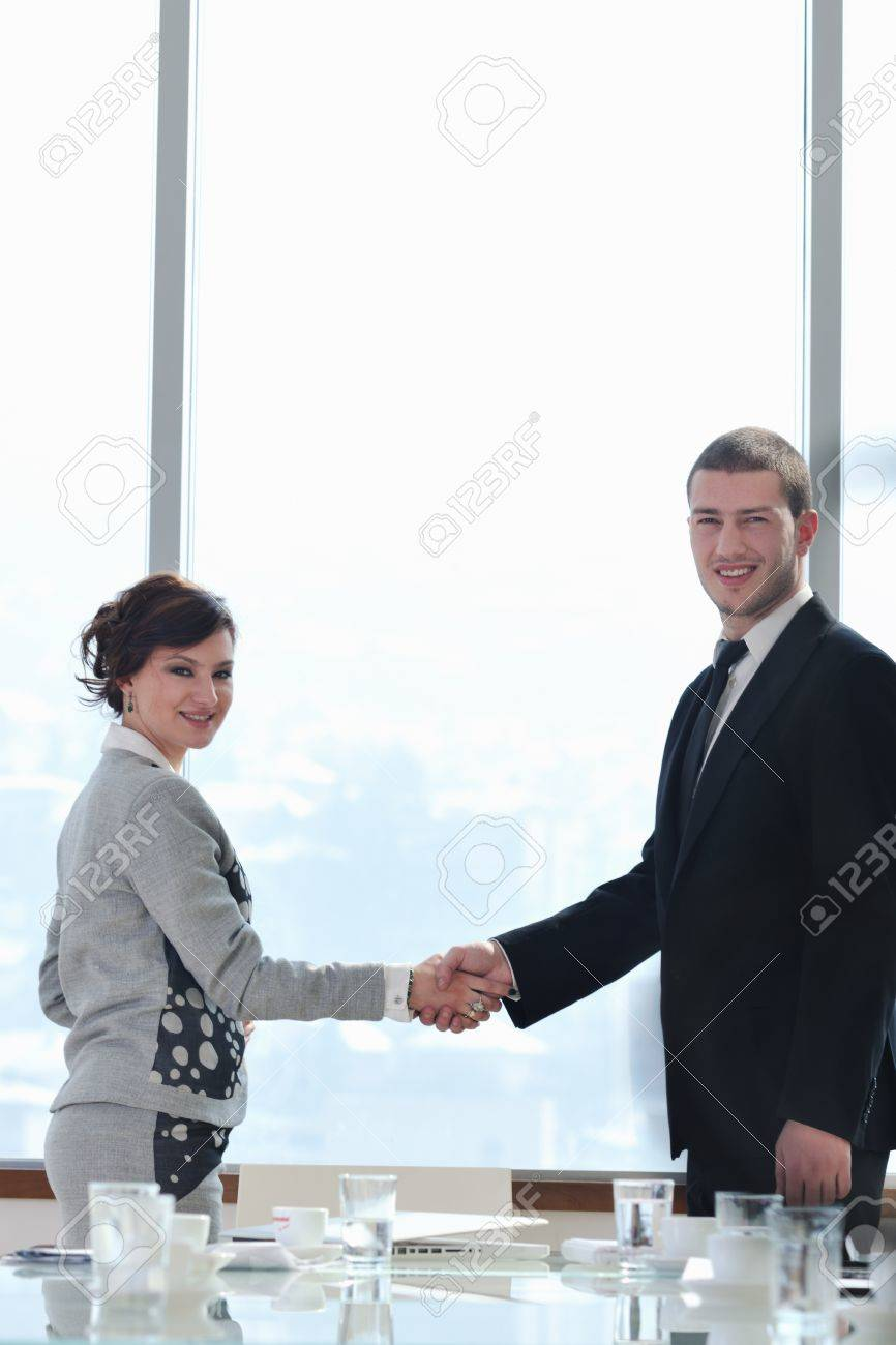 business man and woman handshake on successful  meeting at bright office conference room indoor Stock Photo - 9076180