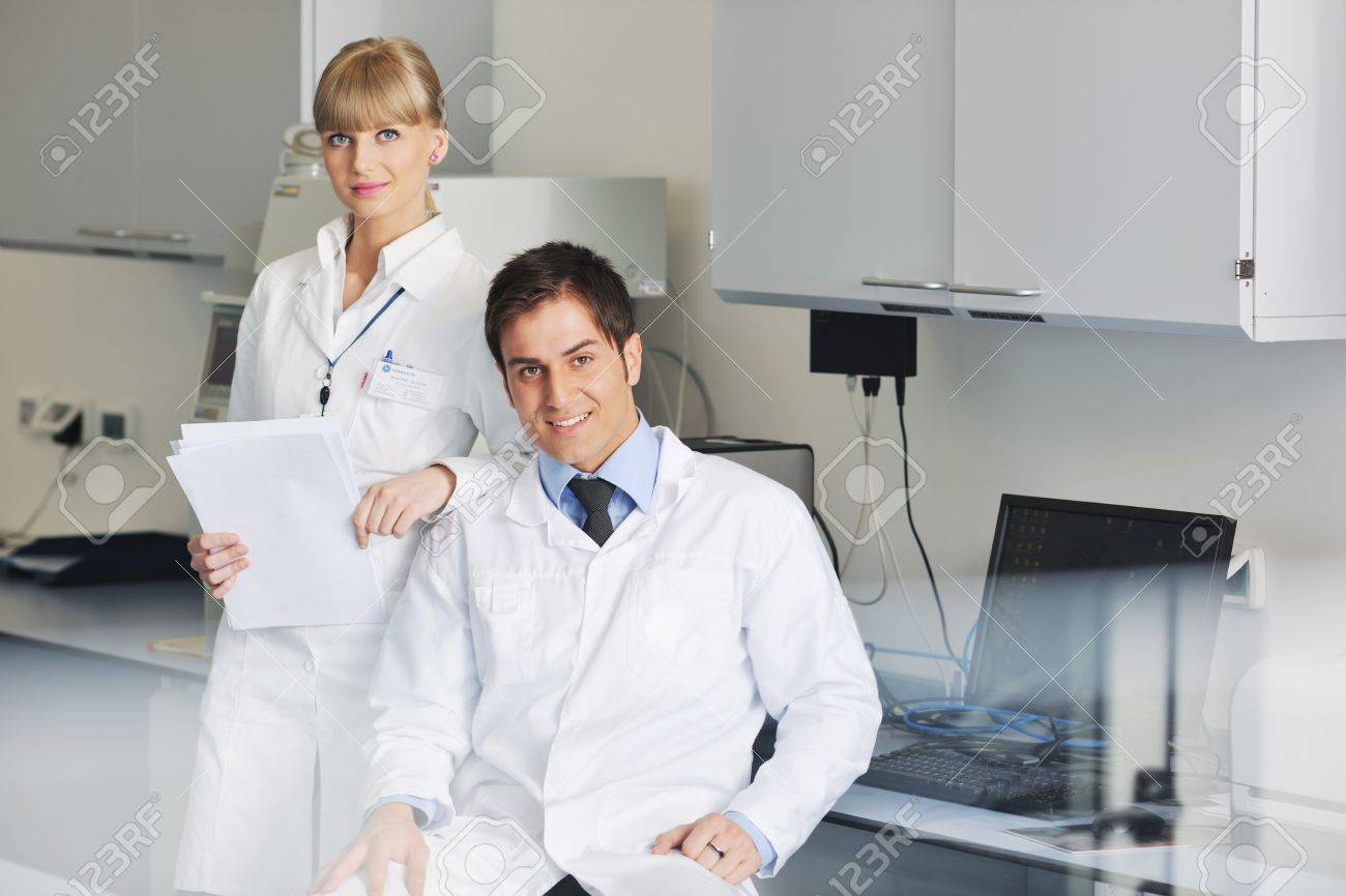 science and research biology chemistry an dmedicine  youn people couple in bright modern  lab Stock Photo - 9404574