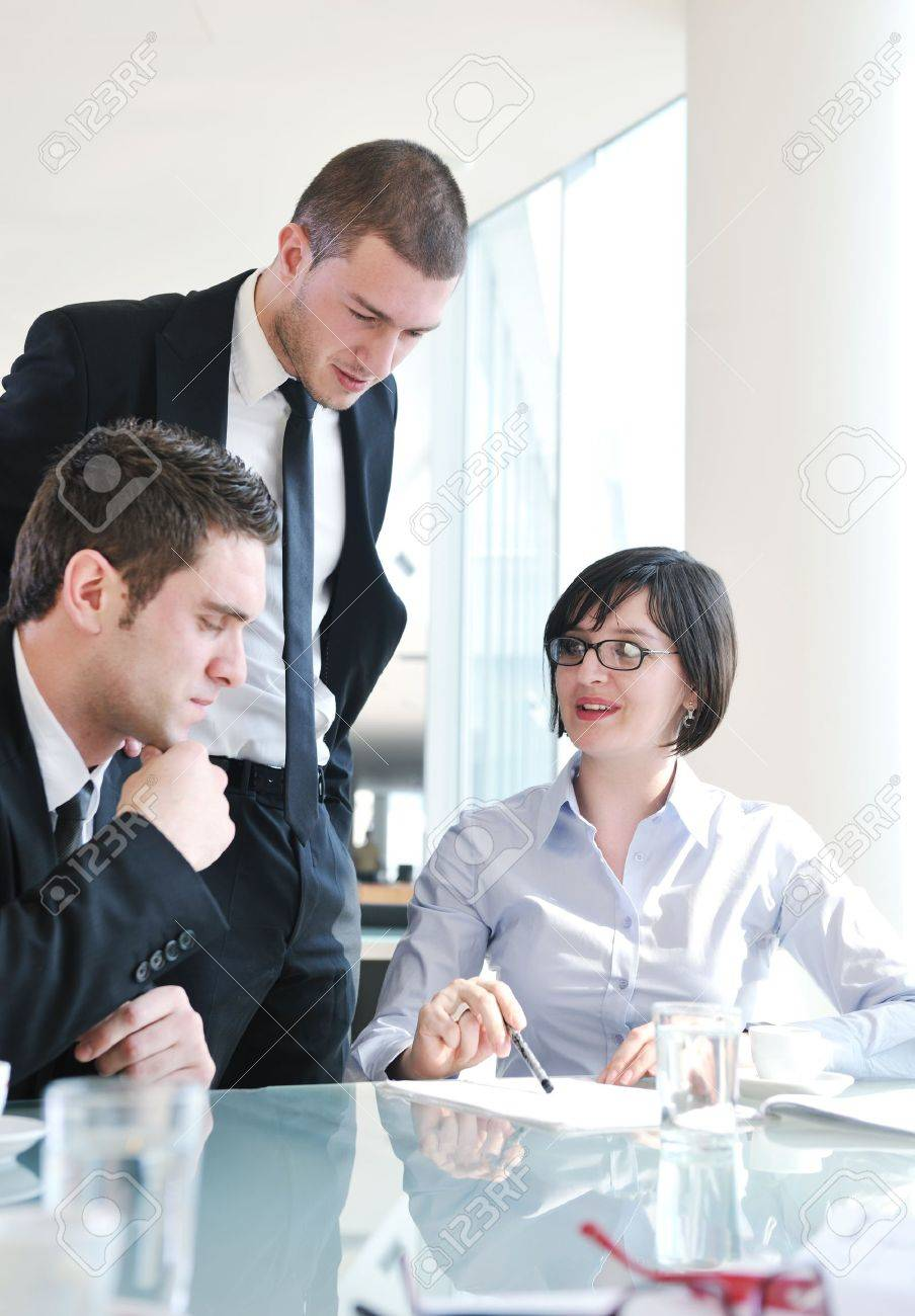young business people group have  meeting at conference room and have discusion  about new ideas  plans and problems Stock Photo - 9619457