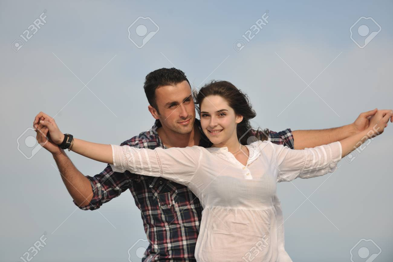 happy young couple have fun and romantic moments on beach at summer season and representing happynes and travel concept Stock Photo - 9619568