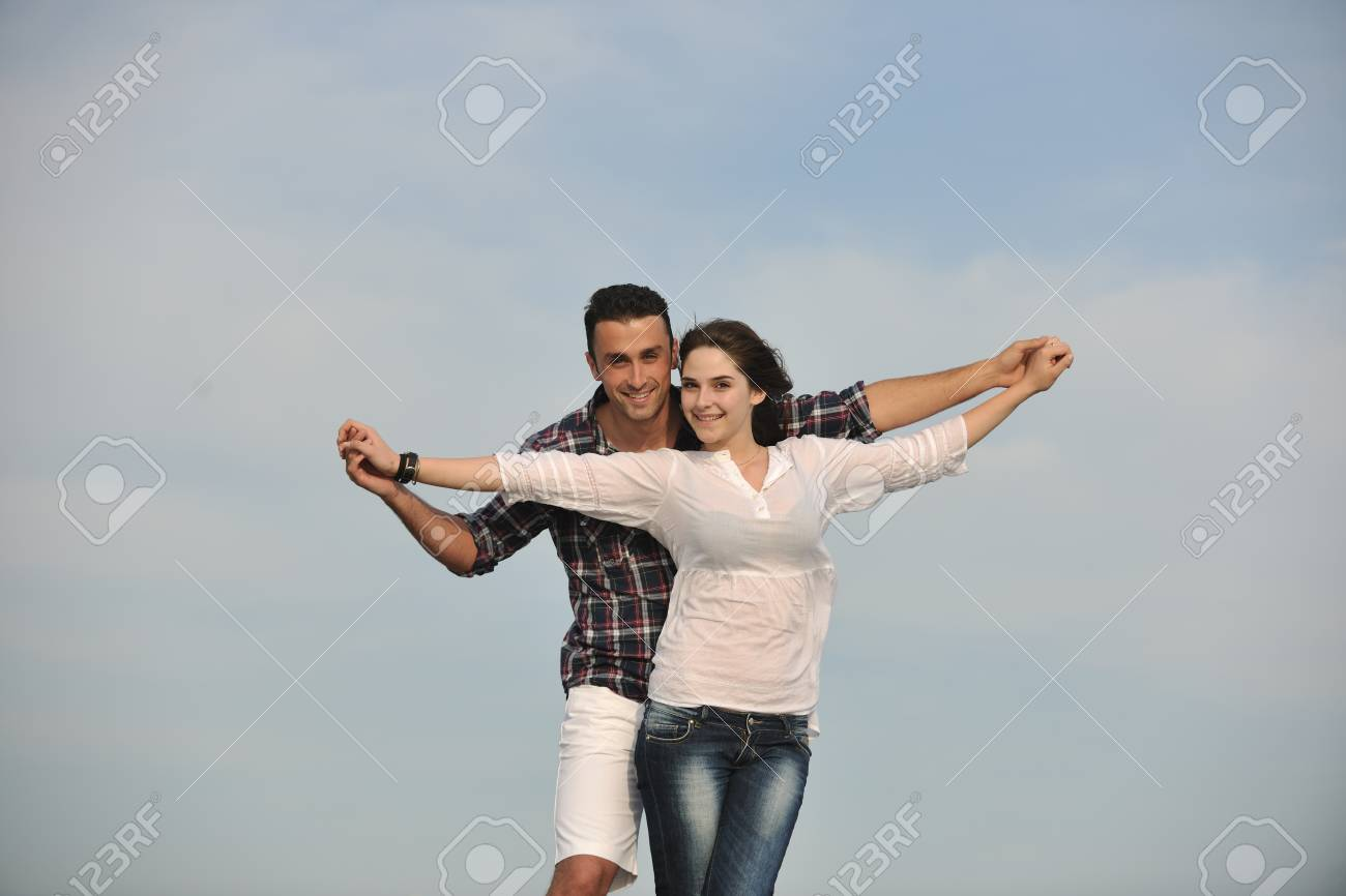 happy young couple have fun and romantic moments on beach at summer season and representing happynes and travel concept Stock Photo - 9619551