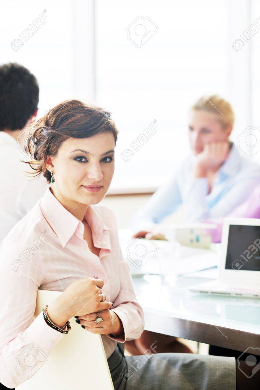 one happy young business woman working on laptop computer at  group team meeting at modern office Stock Photo - 9619491