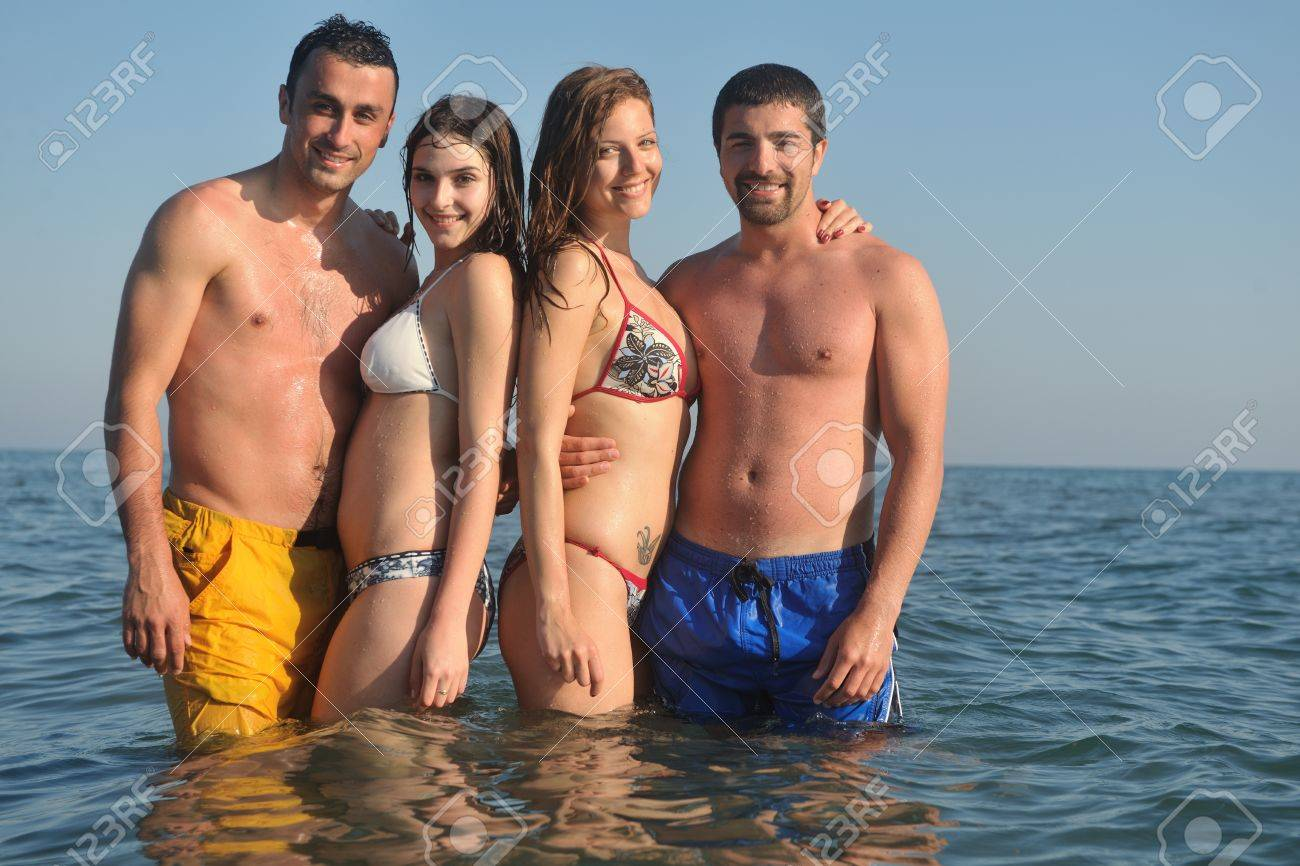 happy people group have fun  run and jump  on beach beautiful sand  beach Stock Photo - 9619652