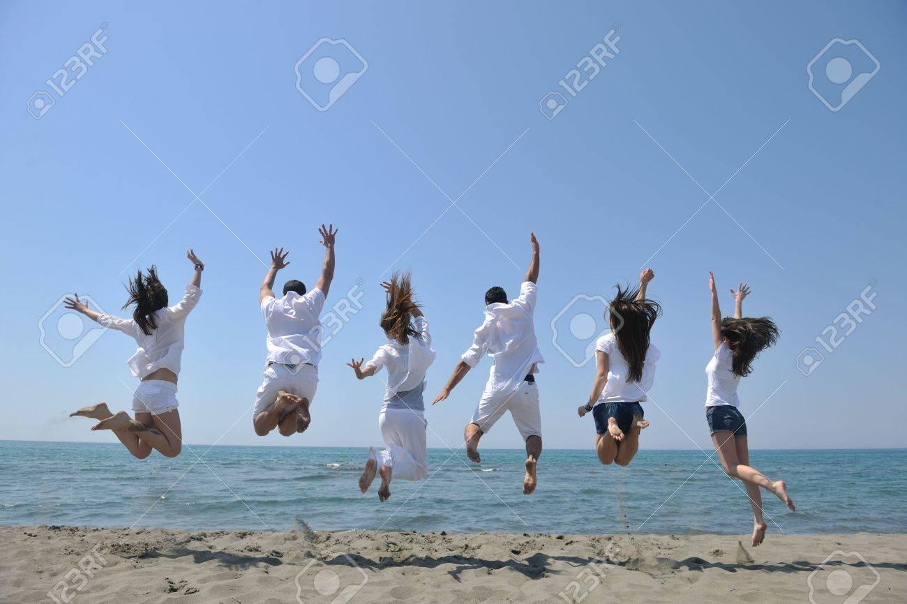 happy people group have fun  run and jump  on beach beautiful sand  beach Stock Photo - 9639652