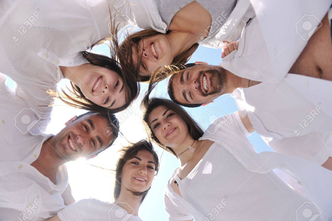Group of happy young people in circle at beach  have fun and smile Stock Photo - 9639895