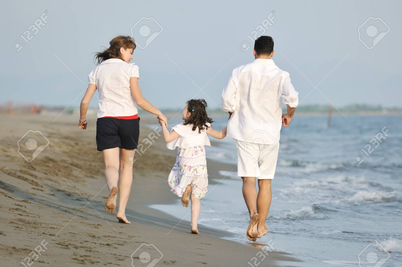 happy young family have fun and live healthy lifestyle on beach Stock Photo - 9712205