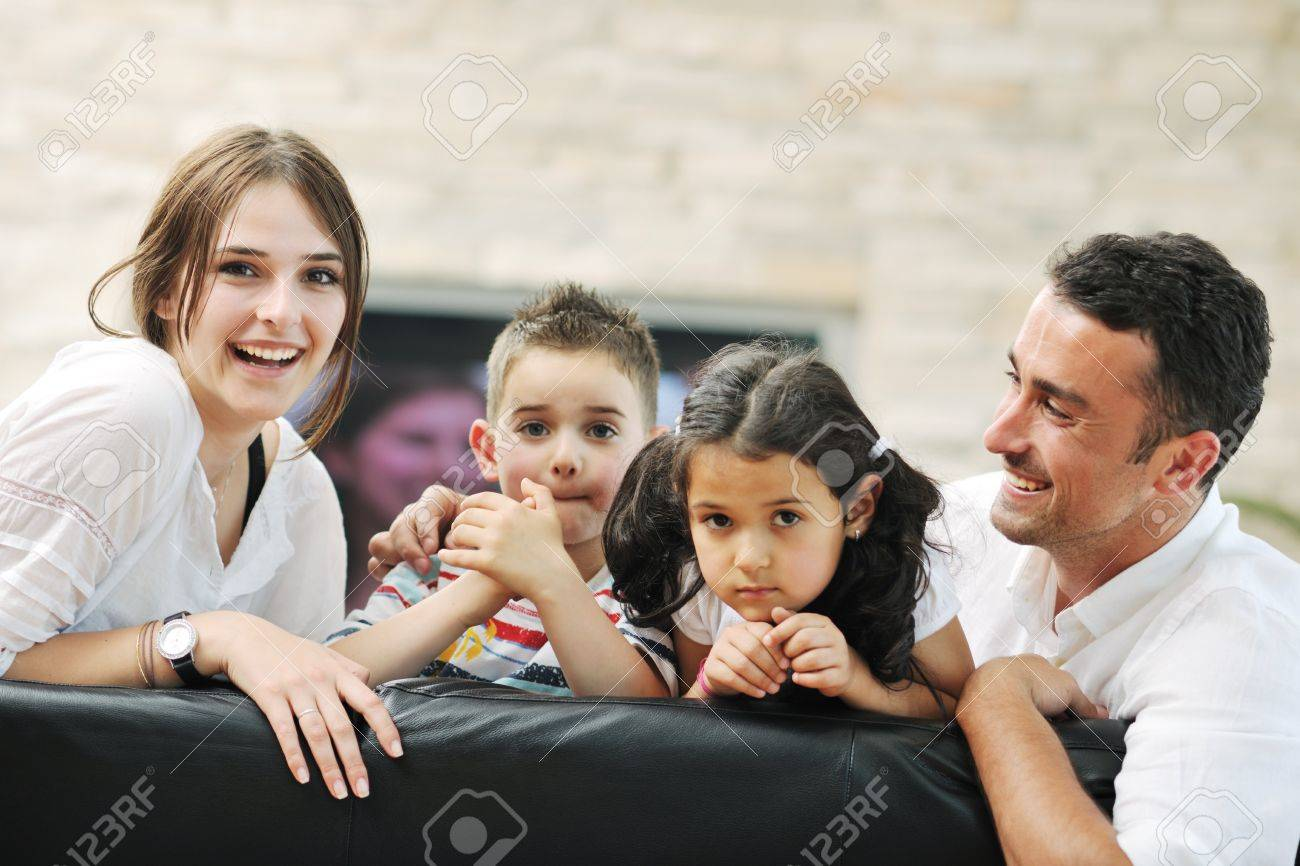 451197ba393 happy young family relax and have fun at modern home indooor Stock Photo -  9727258