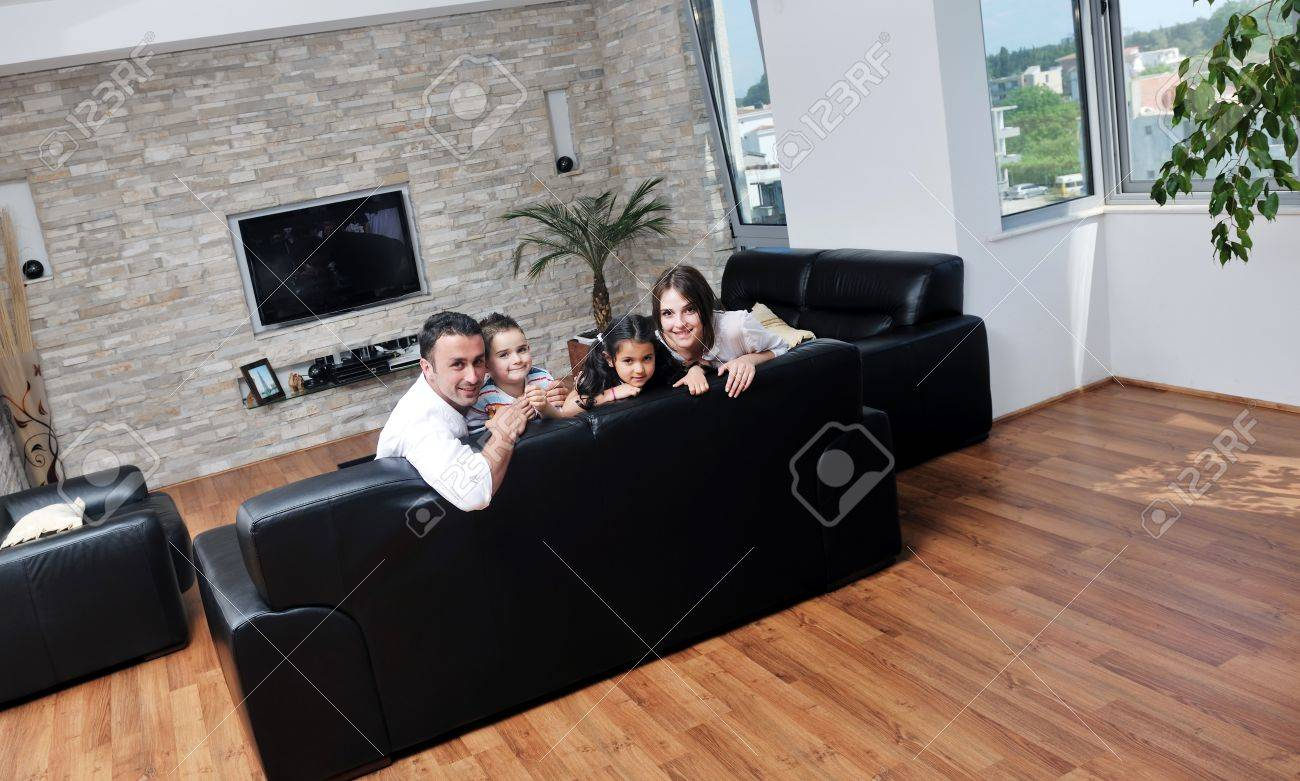 happy young family relax and have fun at modern home indooor Stock Photo - 13256227