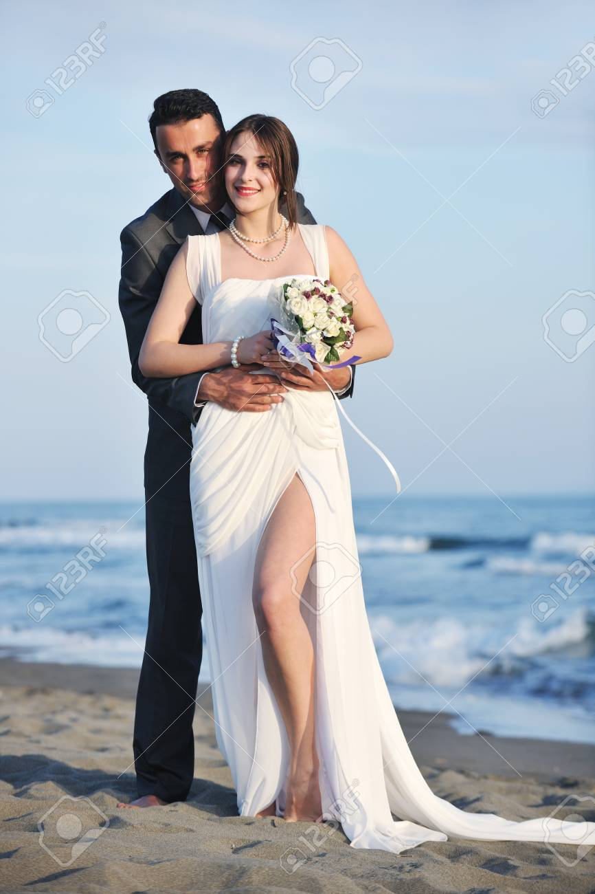 happy just married young couple celebrating and have fun at beautiful beach sunset Stock Photo - 9935899