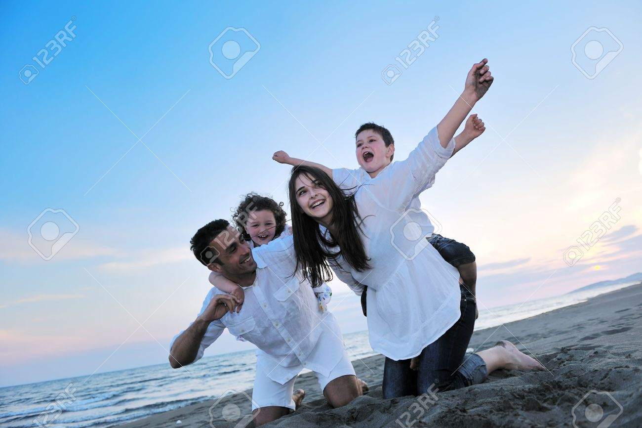 happy young family have fun and live healthy lifestyle on beach Stock Photo - 9900759