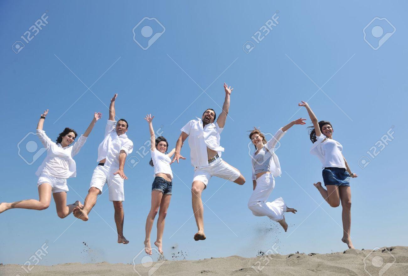 happy people group have fun  run and jump  on beach beautiful sand  beach Stock Photo - 10245252