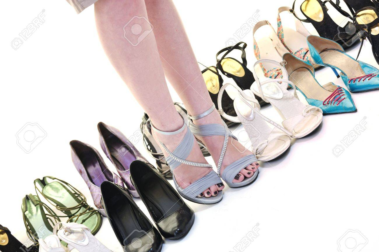 woman buy shoes concept of choice and shopping, isolated on white background in studio Stock Photo - 10191783