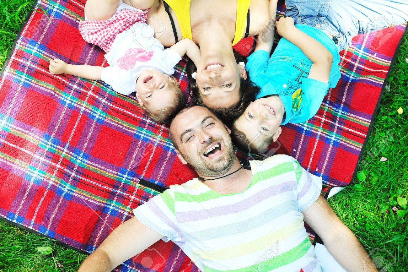 happy young couple with their children have fun at beautiful park outdoor in nature Stock Photo - 10415310
