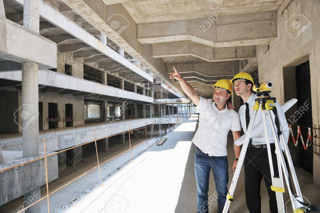 Team of business people in group, architect and engeneer  on construciton site check documents and business workflow on new building Stock Photo - 10540726