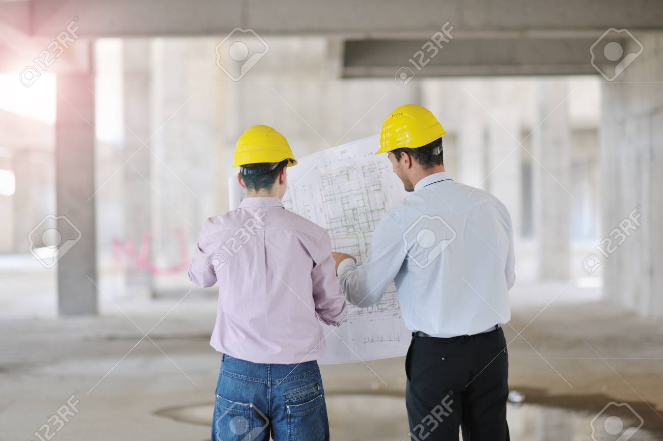 Team of architects people in group  on construciton site check documents and business workflow Stock Photo - 10540876