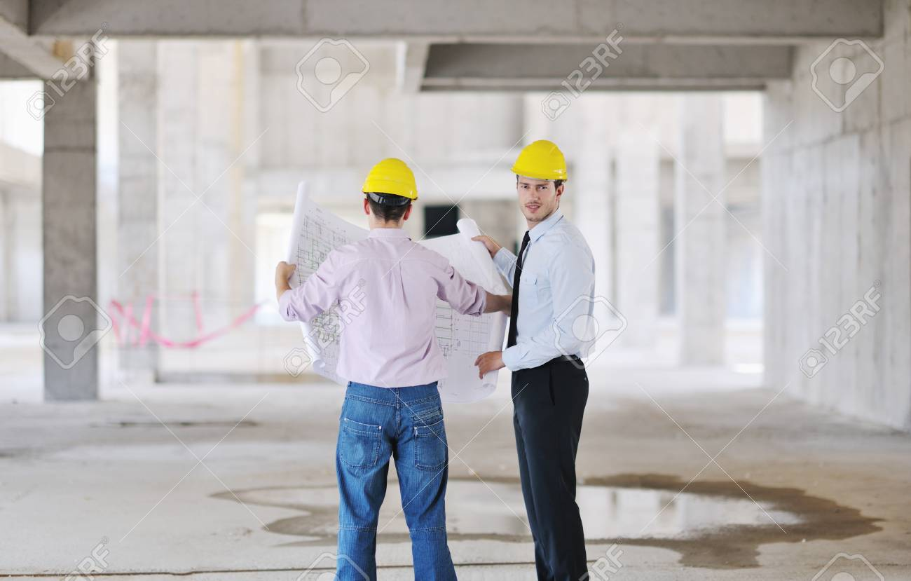 Team of architects people in group  on construciton site check documents and business workflow Stock Photo - 10540710