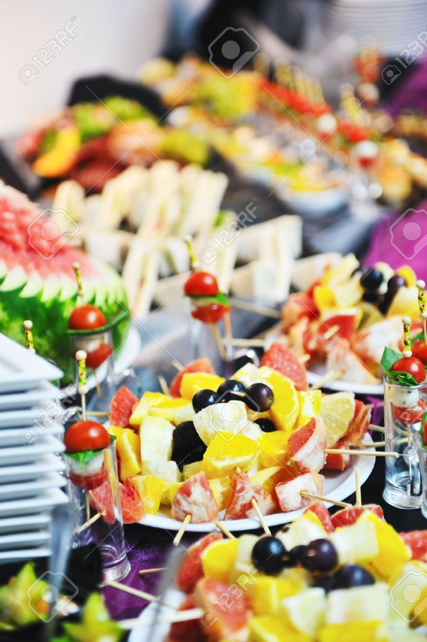 buffed food closeup of  fruits, vegetables, meat and fish arranged on banquet table Stock Photo - 10540816