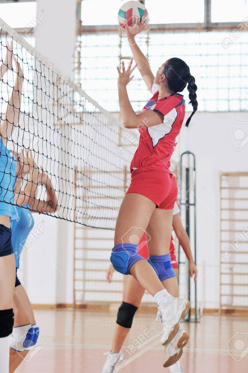 volleyball game sport with group of young beautiful  girls indoor in sport arena Stock Photo - 10650156