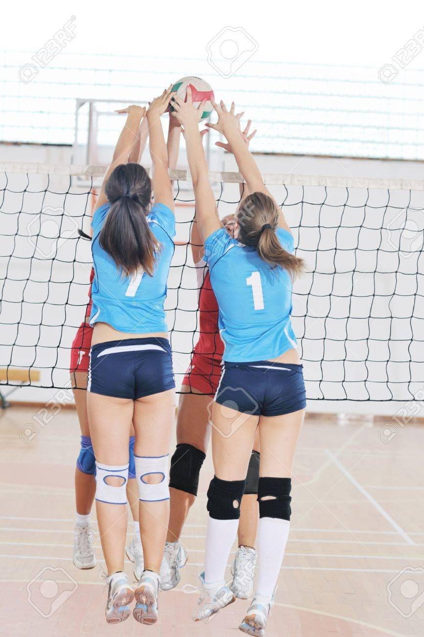 volleyball game sport with group of young beautiful  girls indoor in sport arena Stock Photo - 10650155