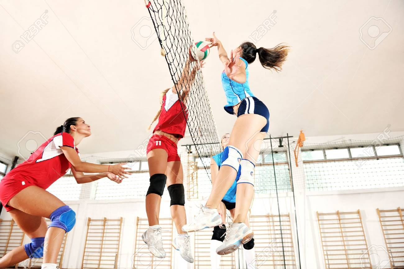 volleyball game sport with group of young beautiful  girls indoor in sport arena Stock Photo - 10650128