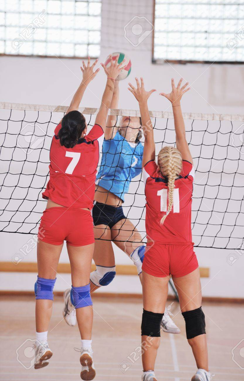 volleyball game sport with group of young beautiful  girls indoor in sport arena Stock Photo - 10650149