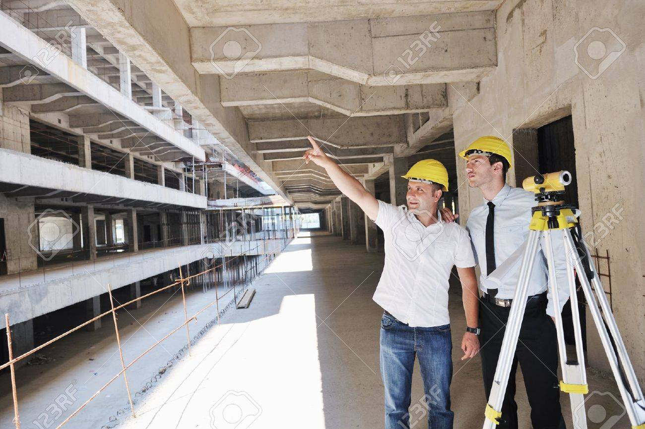 Team of business people in group, architect and engeneer  on construciton site check documents and business workflow on new building Stock Photo - 10665818