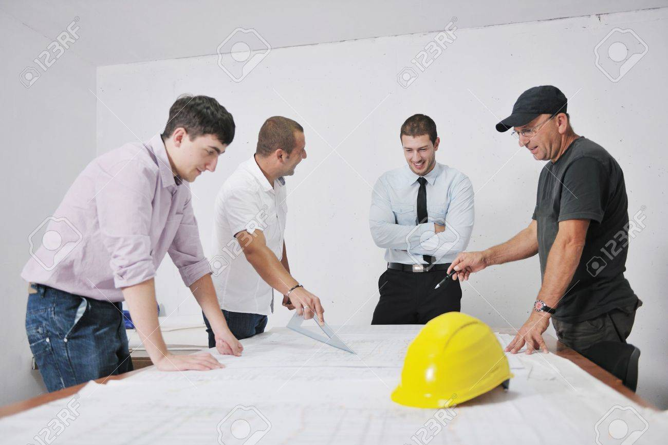 Team of business people in group, architect and engeneer  on construciton site check documents and business workflow on new building Stock Photo - 10778268