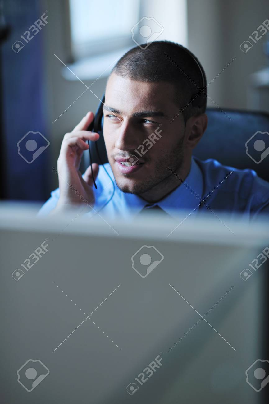 businessman with a headset portrait at bright call center helpdesk support office Stock Photo - 11022402